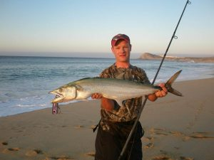 Jansen with a Sierra Mackerel caught Surf Fishing in Cabo