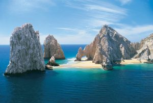 This picture of the majestic stone arch of Cabo San Lucas at the southern tip of Baja California Sur, Mexico, was taken in the morning of February 1989 during a year when sand was under the arch.