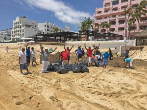 workers-waving-and-removing-trash-o4-sept-17-medano-2012-2